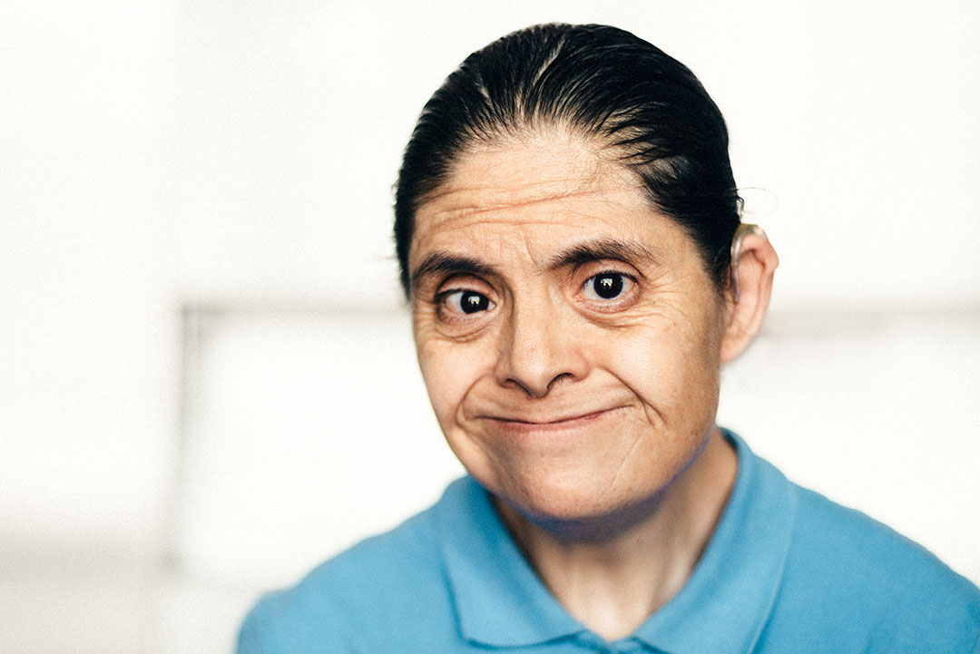 Portrait of an adult Mexican woman with down syndrome.
