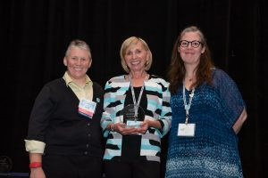 APSE Board President Heidi Maghan, Award Winner Genni Sasnett, and APSE Executive Director Jenny Stonemeier.