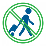 Stop sign in front of person moving with luggage.