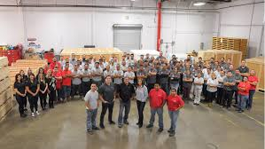 Group of people in a warehouse.