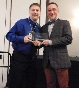 John Witcher accepting an award.