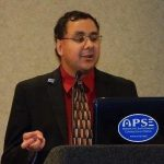 John Lemus speaking with the APSE logo.
