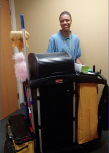 Keshod in front of the environmental services cart at Hannibal Regional Hospital.